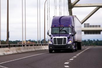 Purple big rig semi truck with dry van trailer for long haul car
